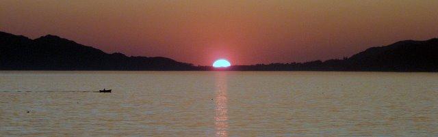 Puesta de sol en la playa de Coria en Portosín